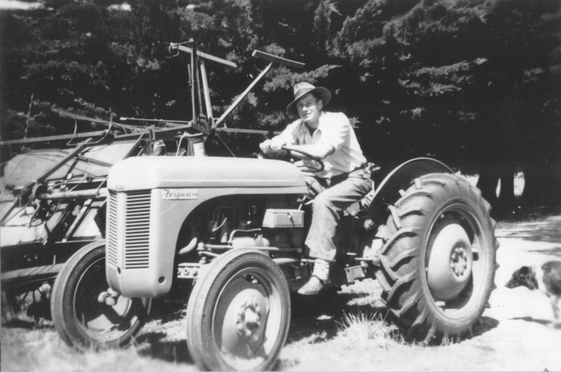 Maurice May on tractor, circa 1948